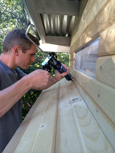 Applying waterproof caulk for nesting box